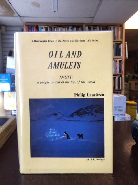 Image for Oil and Amulets : Inuit : A People United at the Top of the World.  First Edition, hardcover in dustjacket